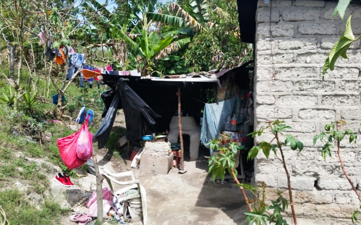 (June) Siguatepeque, Honduras-- HOPE Coffee partnered with a local church, Iglesia Sala Evangelica and Pastor Orlando Japas to provide a kitchen and bathroom for Iris and her family. Iris does not read well so Pastor Orlando shared the gospel by drawing pictures for her.