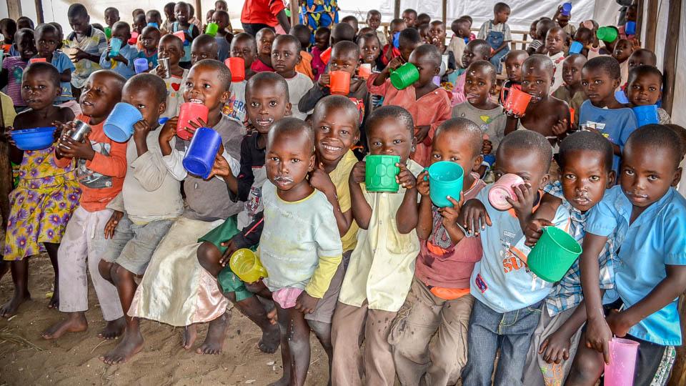 HopeForTomorrowGlobal-Children_drinking_milk-960