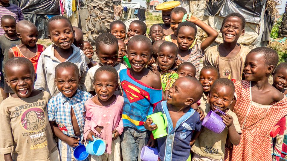 Children in Burundi with milk cups