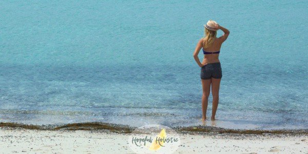 Woman at the beach from Hopeful Holistic