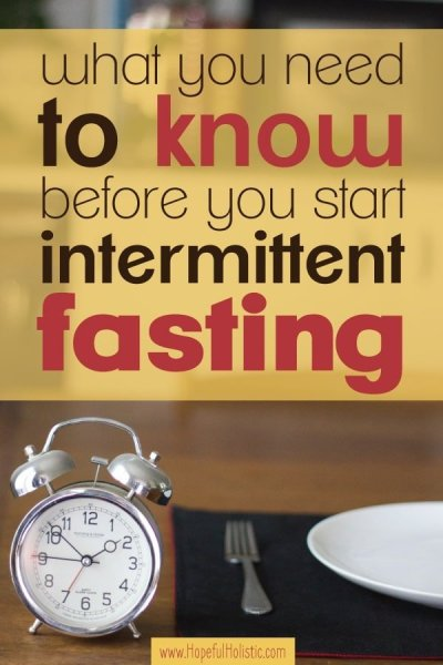 Plate with fork and alarm clock on a table with text overlay- what you need to know before you start intermittent fasting