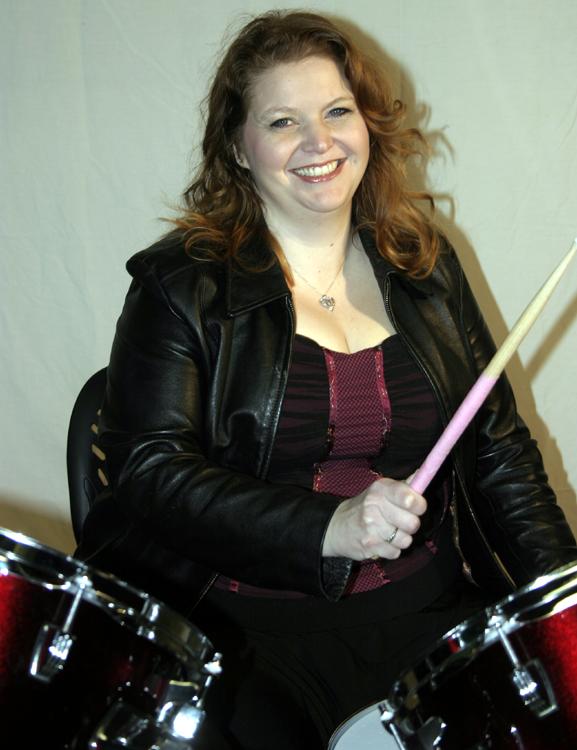 Melanie Hope playing drums