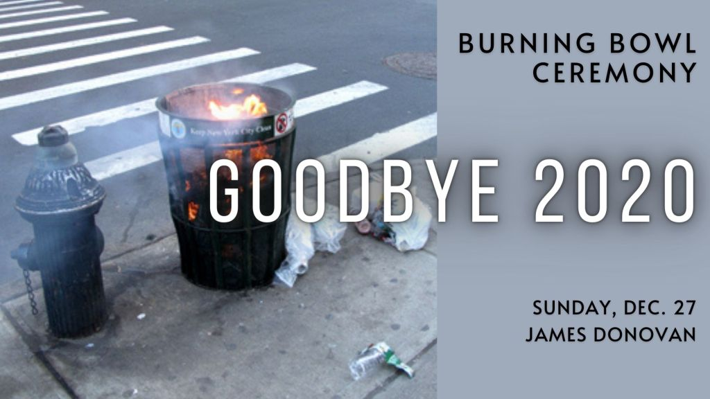 """A fire burns in a trash can with the text """"Burning Bowl Ceremony - Goodbye 2020 - Sunday Dec. 27 - James Donovan"""""""