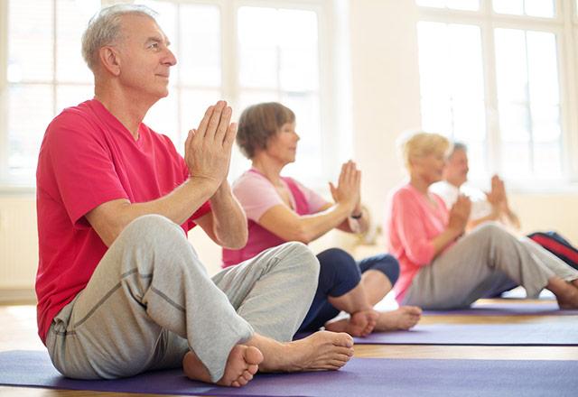 Senior adults practicing yoga.