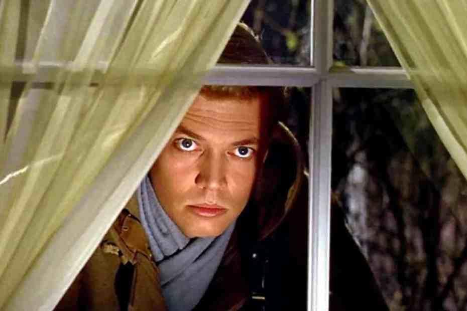 Mark Lewis peering through a window in Peeping Tom