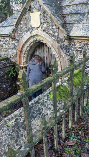 Natascha trying to open the mausoleum door