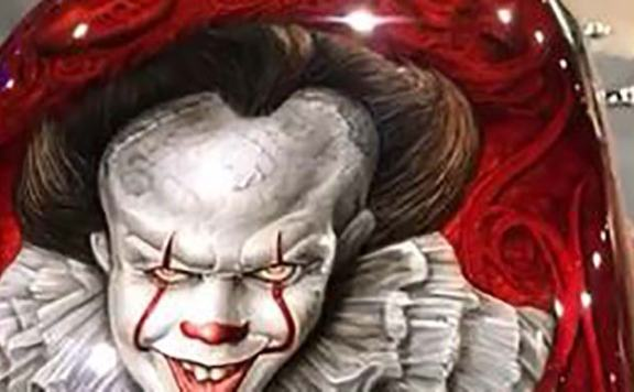 picture of Pennywise painted on a motorcycle