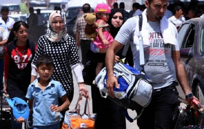 Persone in fuga dall'orrore jihadista
