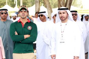 HH Sheikh Mansoor in green