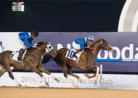 Handassa under Jim Crowley wins the Al Maktoum Challenge