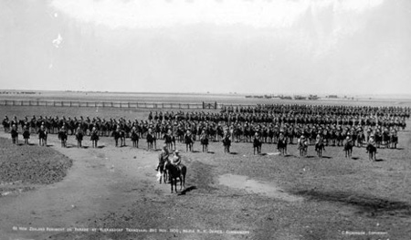 Under the command of Major R. H. Davies, the Fourth Contingent parade at Klerksdorp in the Transvaal, 26 November 1900. © Alexander Turnbull Library