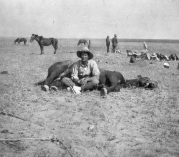 Corporal Williams, probably a member of the New Zealand Auckland Mounted Rifles, resting with his horse in southern Palestine, during World War 1. © Alexander Turnbull Library