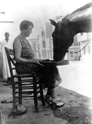 Dorothy Brooke feeding a horse outside the Old War Horse Memorial Hospital in Cairo.
