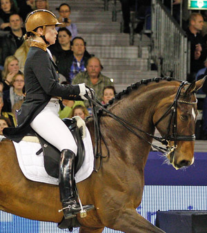 German dressage rider Isabell Werth, pictured on El Santo NRW, is among several high-profile riders advocating the use of riding helmets.