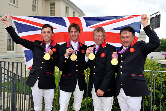Gold medallists Nick Skelton, Ben Maher, Scott Brash and Peter Charles of Great Britain celebrate on the podium after a nail-bitting jump-off with the Netherlands to decide the Team Jumping competition.