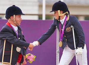 Silver medalist Lee Pearson congratulates Joann Formosa.