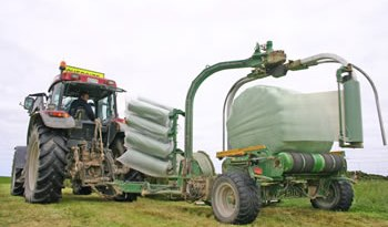 Plastic fantastic: The wrap goes on, sealing off the bale from the atmosphere and getting the ensiling process under way.