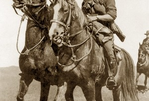 """Australian light horsemen riding waler horses. The soldiers are of the original contingent of the Australian Imperial Force and the photo was taken prior to their departure from Australia in November 1914. The soldier on the right is Trooper William Harry Rankin Woods, 1st Light Horse Regiment, who died of wounds on 15 May 1915, one of the first light horsemen to die during the Battle of Gallipoli."""""""