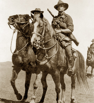 Australian light horsemen riding waler horses. The soldiers are of the original contingent of the Australian Imperial Force and the photo was taken prior to their departure from Australia in November 1914. The soldier on the right is Trooper William Harry Rankin Woods, 1st Light Horse Regiment, who died of wounds on 15 May 1915, one of the first light horsemen to die during the Battle of Gallipoli.""