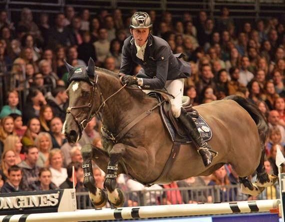 Ben Maher and Tripple X III on their way to winning the Olympia Grand Prix.