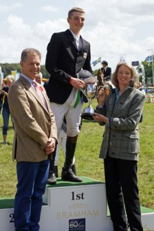 Tom Jackson (GBR) receives his prize from Anne Palling of Bishop Burton, and Bramham Estate owner Nick Lane-Fox