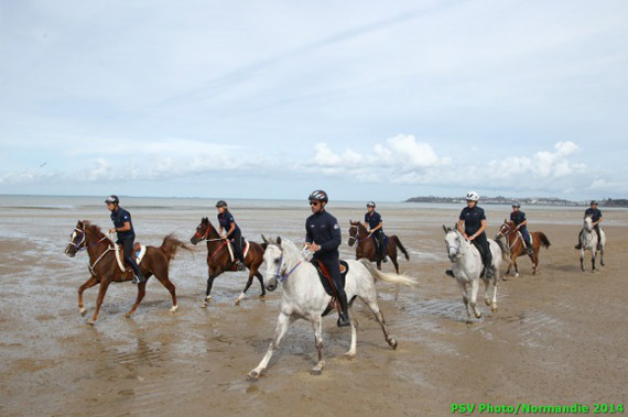 Endurance riders enjoy a canter on the beach as they prepare for competition on Thursday.