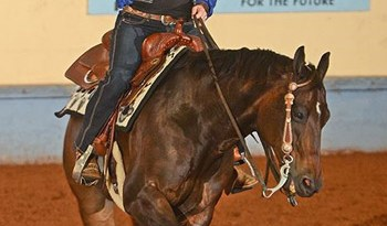 Lara Oles at the 2014 NRHA Futurity riding Western Whiz, owned by Bob Thompson and Lisa Coulter, where the pair won the first ever Para Reining Championship trophy.