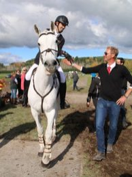 Clarke Johnstone is congratulated by Erik Duvander after his jumping round.