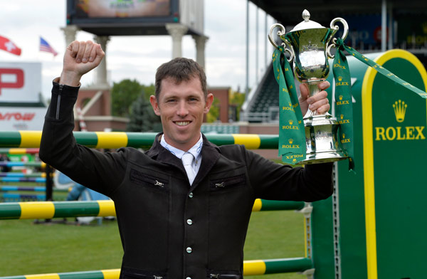 Scott Brash, the first rider ever to win the Rolex Grand Slam of Show Jumping, with the Rolex Grand Slam Trophy.