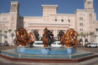 The elaborate fountain at Al Qasr features eight double life-sized bronze abstract horses, created by Danie de Jager.