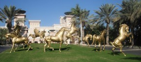 The golden arabian horses of Al Qasr, sculpted by Danie de Jager.