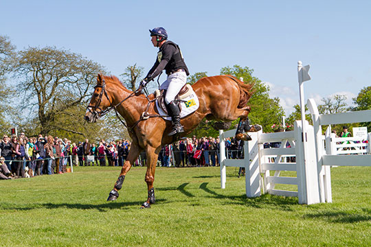 British rider Oliver Townend and Armada jumping Badminton's Garden Gates in 2015.