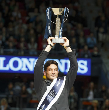 Steve Guerdat holds the Longines FEI World Cup Trophy aloft after his win in Gothenburg on Monday night.