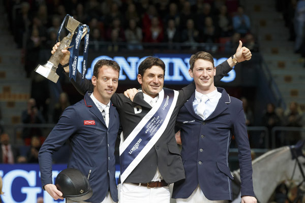 Steve Guerdat gives a big thumbs up on the podium after winning theLongines FEI Jumping World Cup in Gothenburg on Monday night. At left is runner-up HarrieSmolders, and at right is third-placed DanielDeusser.© Hippo Foto - Dirk Caremans