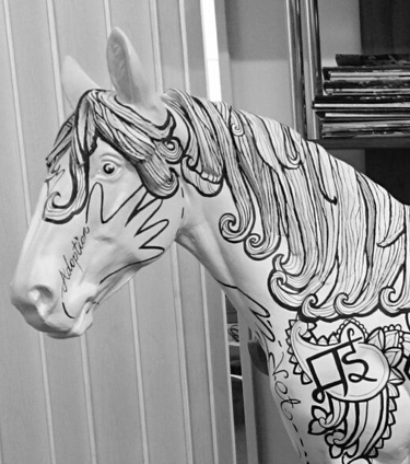 "Judi Milne's ""16 pairs of hands"" work designed by field officer Claire Gordon will be coloured in by visitors to the World Horse Welfare stand at Badminton."