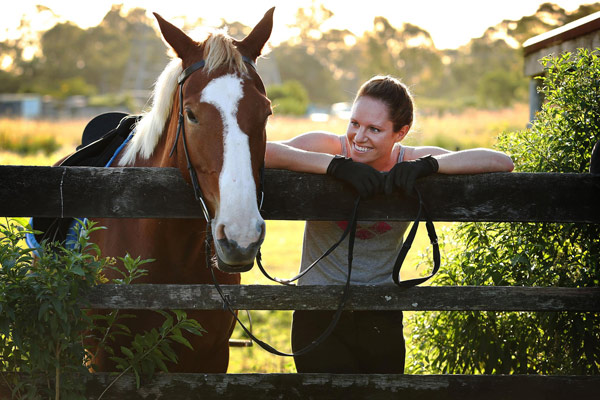 Australian Olympic swimmer Emily Seebohm and one of her horses, Platinum.
