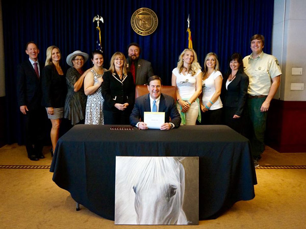 Governor Doug Ducey said he was proud to sign the legislation protecting the Salt River wild horses. Photo: Governor Doug Ducey/Facebook