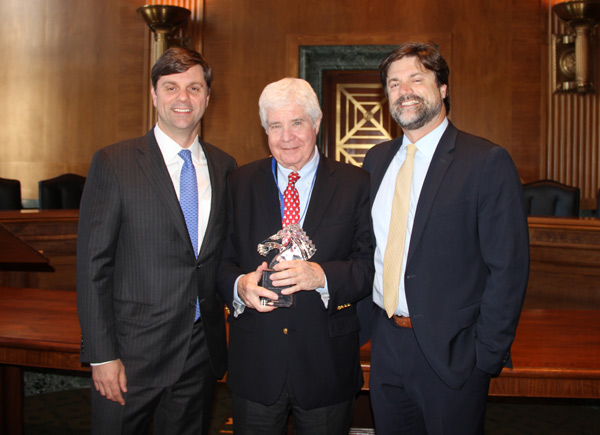 Jay Hickey, at center, is presented with the Rolapp Award by Brian Rolapp, left, and Todd Rolapp.
