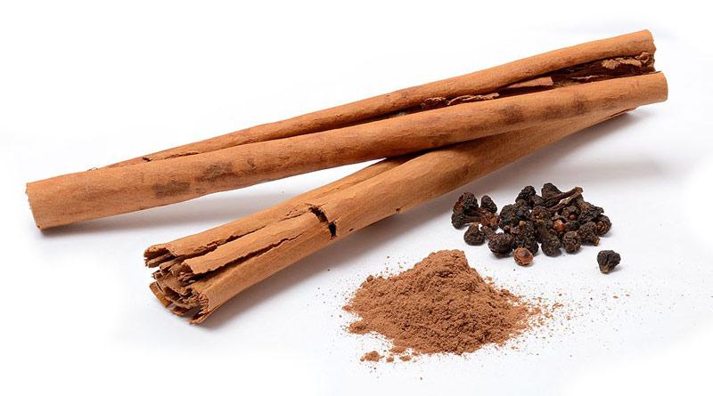 Cinnamon sticks from Sri Lanka, powder, and dried flowers.