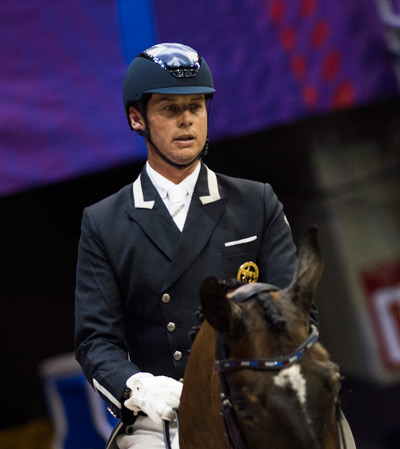 Carl Hester dons a helmet on Nip Tuck in the Grand Prix at the FEI World Cup Dressage Finals at the weekend.