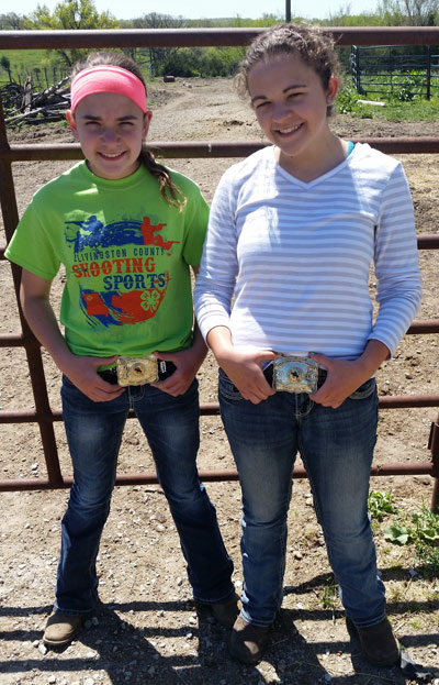 Jessie, left, and Josie, right, proudly show off their National Championship buckles.