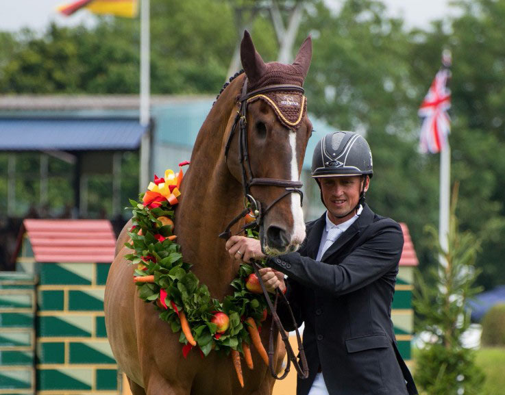 Trevor Breen with Adventure De Kannan at his retirement ceremony at Hickstead.