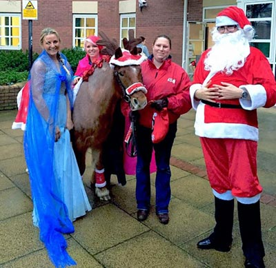 Dillon at Worcester Children's Hospital, helping Santa deliver presents.