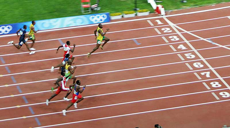 Bolt holds a sizeable lead over his rivals in the closing stages of the 2008 100-metre final at the Beijing Olympics. Photo: By Usain_Bolt_winning.jpg: PhotoBobil derivative work: SeizureDog CC BY 2.0 via Wikimedia Commons