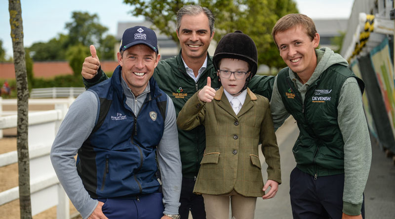Cian O'Connor, Chef d'Equipe Rodrigo Pessoa and Bertram Allen meet Oisin O'Connell, age 7, from Clashmore, Co Waterford at the RDS Simmonscourt arena in Ballsbridge, Dublin.