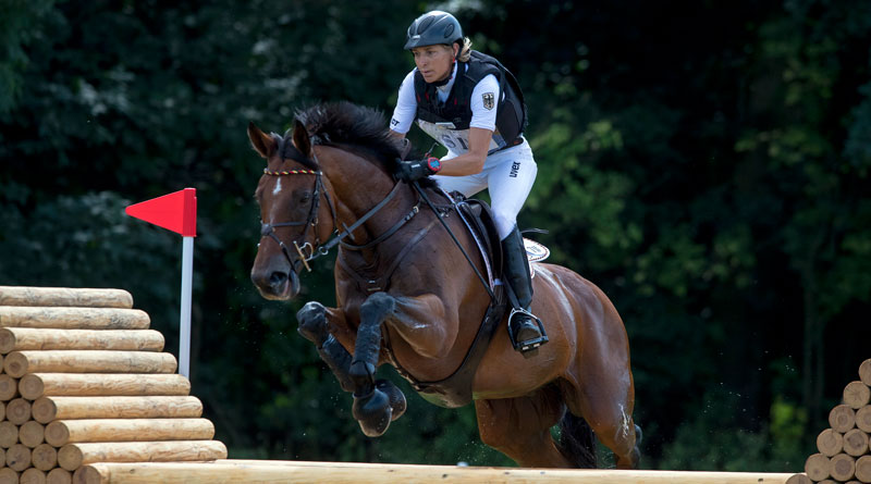 Ingrid Klimke and Hale Bob on the cross country at FEI European Eventing Championships in Strzegom, Poland.