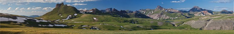 The Uncompahgre Wilderness in Colorado consists of gently rolling alpine tundra meadows, rugged, mountainous landscapes, and densely-forested canyons within the north-central San Juan Mountains.