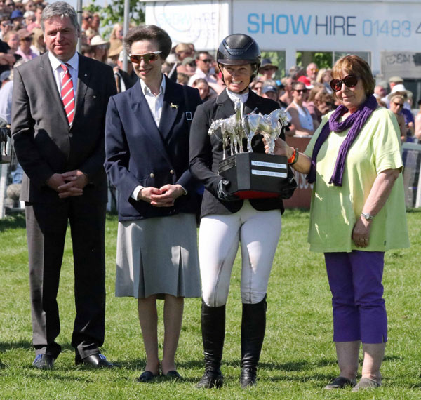 Jonelle Price accepts the Badminton Trophy from Princess Anne, the Princess Royal after her win on Classic Moet.