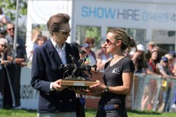 Princess Anne presents Holly Fitzgerald with the Mark Holliday Memorial Trophy, presented to the groom of the winner.