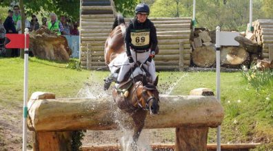 Pippa Funnell and Billy Beware falling at The Hildon Water Pond.